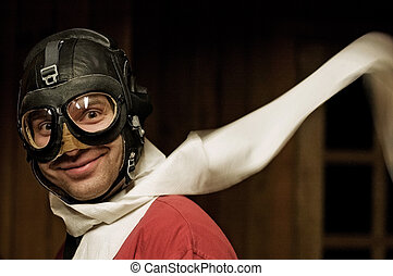 Smiling man with helmet and flying goggles