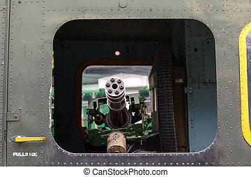 minigun in the door helicopter Bell UH-1 Iroquois - M134...