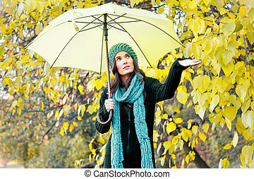 beautiful young girl under yellow umbrella - Young beautiful...