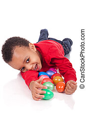 Easter egg hunt - boy with easter eggs, isolated on white