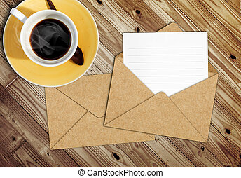 blank letter with the envelope on coffee table