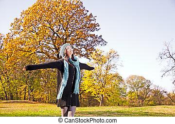 Happy pretty woman at the autumn park. - Happy pretty woman...