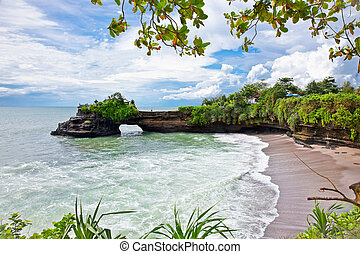 Beautiful beach and Pura Batu Bolong temple on Bali. -...