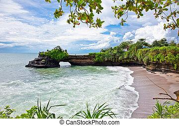 Beautiful beach and Pura Batu Bolong temple on Bali. -...