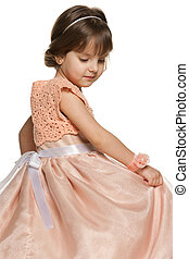 Thoughtful little girl in a ball gown - A thoughtful little...