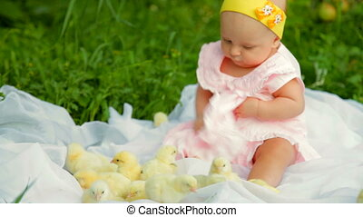 Baby with chicken - Baby girl with chicken sitting in the...