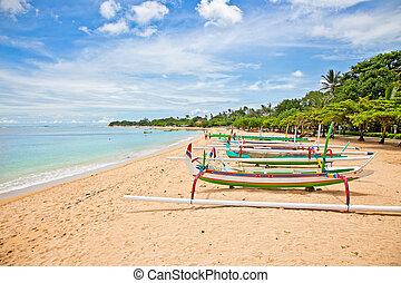 Beautiful tropical beach with fishermans boats in Nusa Dua...