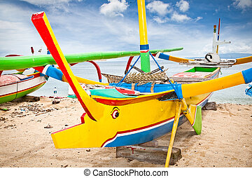 Fishing boats on a beach, Nusa Dua, Bali Indonesia -...