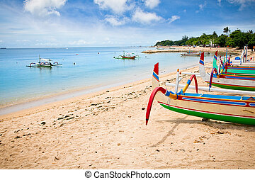 Traditional fishing boats on a beach in Nusa Dua on Bali....
