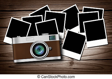 blank instant photos on old wood background with classic camera