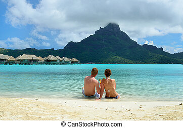 Romantic honeymoon couple on Bora Bora - A honeymoon couple...
