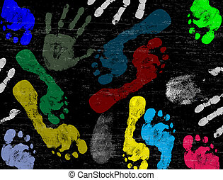 Abstract vector hand and foot prints on black grunge...
