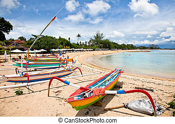 Traditional fishing boats on a beach in Sanur on Bali