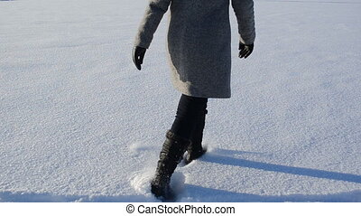 woman heart shape snow - woman walking in light snow forming...