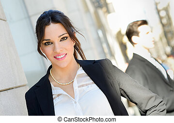 Portrait of an attractive businesswoman standing outside of...