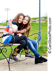 Friendly hug - Teenage girl comforting her friend hugging...