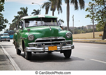 Classic green Plymouth in new Havana - HAVANA-JANUARY...