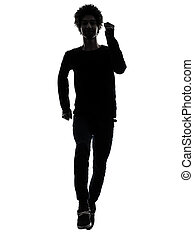 handsome african young man running  silhouette