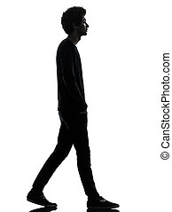handsome african young man walking silhouette