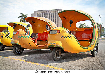 Yellow coco taxi in Havana - HAVANA-FEBRUARY 2: Yellow coco...