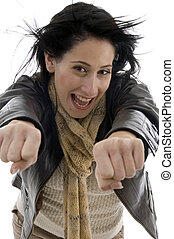 woman showing clenched fists on an isolated white background