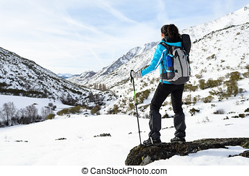 Woman winter mountain hiking