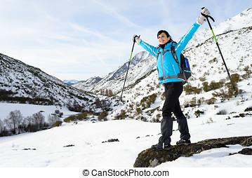 Happy woman winter mountain hiker