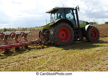 tractor closeup plow furrow agriculture field - tractor...