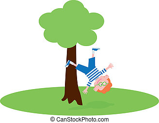 Boy falling from the tree on the green grass