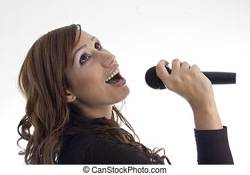 woman singing in microphone on an isolated background