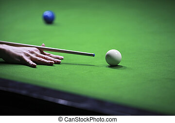 Snooker hit - Snooker player hitting the cue ball