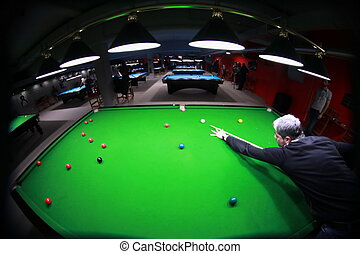 Snooker player - A snooker player hitting the cue ball, shot...