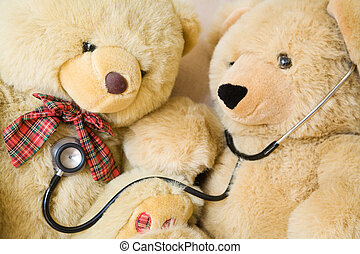 Doctor and Patient - Teddy bears with stethoscope posing as...