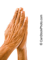 Old hands praying - An old asian woman holds her hands in...