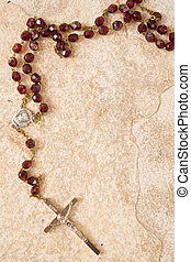 Rosary on stone with copy space - Rosary beads on a...