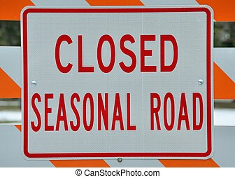 Seasonal Road Sign stating that the road is closed