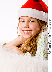 Christmas child - Happy blond girl and her christmas...