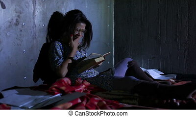 Young untidy woman - Young untidy woman reading book at...