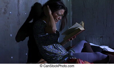 Young untidy woman - Young untidy woman reading book and...