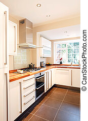 Modern kitchen - Modern white kitchen with wooden worktops...