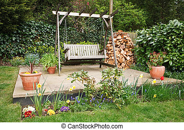 Garden patio - Relaxing garden patio with swing bench,...