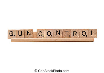 Gun Control scrabble word isolated on white - Gun Control...