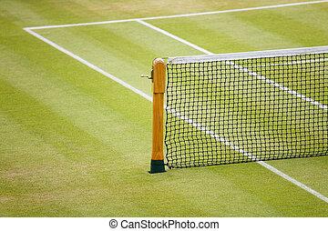 Tennis net - Detail of a tennis net and post on a grass...