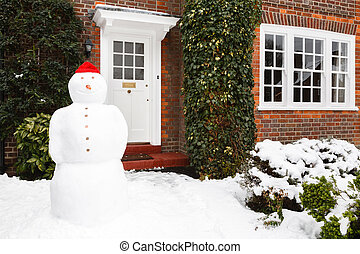 Snowman outside house - Snowman in front garden of home in...