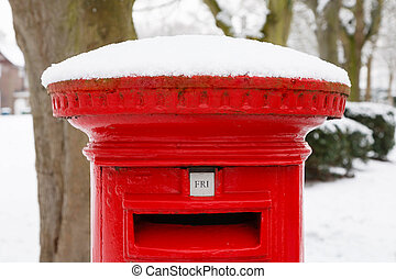 Post box with snow - Traditional English red postbox covered...