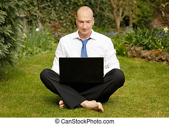 Working from home - Successful businessman in white shirt...
