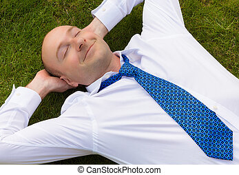 Business man relaxing - Businessman in shirt and tie...