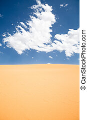Desert sky - Barren desert landscape with colorful blue sky...
