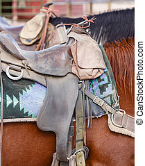 Western saddle - Closeup of western US style horse tack and...