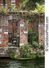 Riverside garden - Walled garden on a riverbank in...